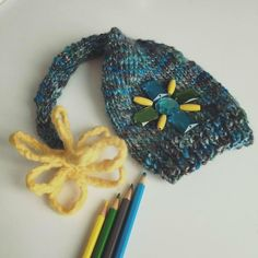 Newborn lady hat. Designed and handknitted by PETIT MORICZ. Made in SWITZERLAND