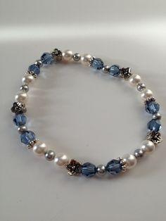 Swarovski denim blue crystal & white pearl bracelet . $12.50, via Etsy.