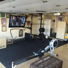 Garage Gyms | Create your own gym in your garage #garage #gym | Protect the equipment in your garage gym with a garage door from Wayne Dalton: http://www.wayne-dalton.com/residential/Pages/garage-doors.aspx