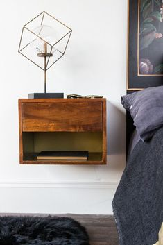 Front-on lifestyle image of the Mango Wood Wall-Hung Bedside Shelf Wall Mounted Bedside Table, Bedside Shelf, Bedside Table Design, Wood Nightstand, Bedside Tables, Minimalist Bed Frame, Vintage Bedroom Styles, Gold Shelves, Table For Small Space