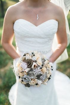 Paper, burlap, and brooch wedding bouquet with feathers {Barbara B Covington Photography}