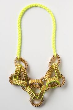 Crepe Chain Neon....unusual piece...looks much more expensive than the price.  I see it with a summer lazy dress, or with a blazer and jeans.
