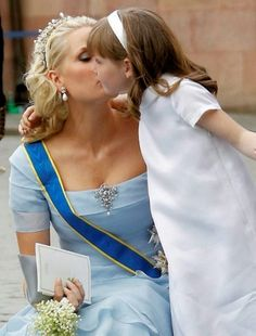 Crown Princess Mette-Marit of Norway with her daughter Princess Ingrid Alexandra. Attending Crown Princess Victoria of Sweden's wedding. Ingrid was a bridesmaid - and she is Victoria's goddaughter.