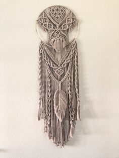 Delicate feather and soft fringe details contrast with bold elements to form a perfectly balanced touch to your space. Macrame Projects, Diy Mirror, Macrame Knots, Macrame Patterns, Milk And Honey, Warm Grey, Craft Gifts, Wall Tapestry, Weaving