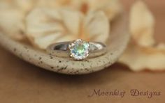 Opalescent Topaz Artisan Solitaire Engagement Ring in Sterling - Silver Rainbow Promise Ring or Commitment Ring - Diamond Alternative.  This ring has a classic look with a modern vibe!  Repin this sleek ring to your own inspiration board!