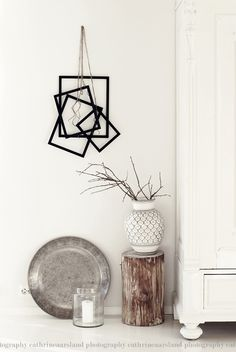 ♥ love the hanging picture frames.