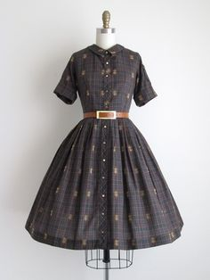 Vintage 1950s Dress ◊ Patch Pocket Dress This dress is plaid cotton. It has a pleated skirt, and is pictured over a crinoline. The dress