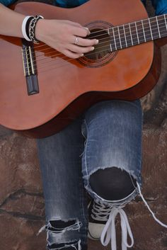 girly girl with long nails playing a guitar