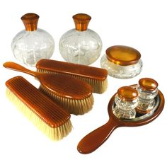 Antique 9 Pc. Vanity Set, Blond Tortoise Shell - 5 Jars, Cologne  England  Edwardian to Victorian  A Fine Edwardian to Victorian vanity set comprised of 10 items (title says 9, but a second hair brush will be included which has a repair to handle). The set is a stunning example of fine amber-colored blond tortoise shell of finest quality. The brushes are boar-bristled, in unused condition and sanitized. No loss to the brushes shown. There is a second long-handled hair brush which will be sent...