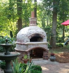 Find a way to build one ~ Brick Oven! Key to have convenient wood storage nearby/underneath. also love the fountain, any water feature sounds! Brick Oven Outdoor, Pizza Oven Outdoor, Outdoor Cooking, Outdoor Bars, Outdoor Kitchens, Wood Oven, Wood Fired Oven, Outside Living, Outdoor Living