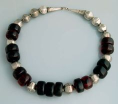 Africa | Necklace from the Harar region of Ethiopia | Silver and Bakelite or resin | These synthetic beads where brought to the region by European traders in the early 20th century as a substitute for the far more expensive Amber.  This type of necklace is highly valued among the peoples living in the horn of Africa.