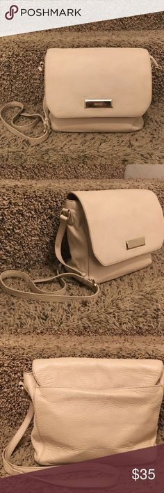 AUTHENTIC DKNY BEIGE SOFT LEATHER CROSS BODY BAG HI LADIES AS YOU CAN SEE THIS PURSE HAS BEEN USED AND LOVED BUT STILL HAS SO MUCH LIFE LEFT IN IT! THE INSIDE IS IMMACULATE AND THE OUTSIDE IS STILL IN GOOD CONDITION! IT IS 100% GENUINE SOFT LEATHER! HAS MINOR WEAR AND TEAR THAT IS HONOSTLY NOT VISIBLE AT ALL!  WHAT I LOVE ABOUT THIS PURSE IS YOU CAN FIT A FULL SIZE WALLET IN IT.  GREAT FOR EVERYDAY USE! ❤️💋 (posting more pics in the next post to show u wear and tear.  l'm very honost about…