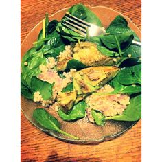 roasted avocado over spinach&couscous salad