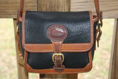EUC Authentic Dooney & Bourke Navy AWL Bag. Starting at $35 on Tophatter.com!