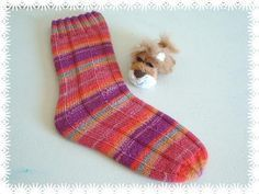 Tube socks, knit in the round.  EASY!