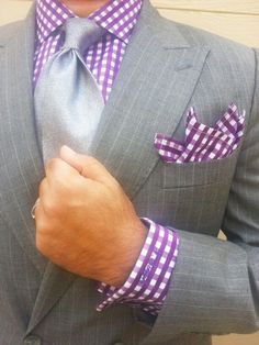 purple gingham shirt don't match pocket squares with shirt or tie... Pet peeve.. Be unique