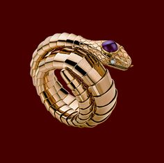 Bulgari gold, ruby, and diamond snake  bracelet, 1950.