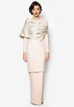 Karla Baju Kurung from Jovian Mandagie for Zalora in Pink For a modern revival of the classic baju kurung, very few brands craft it as good as Jovian Mandagie for Zalora. With a traditional brocade drape as its centrepiece, this two-piece stunner is flourished with floral-themed lace complete with p... #bajukurung #bajukurungmoden