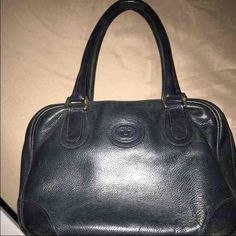 Authentic vintage Gucci handbag This is a small authentic Gucci handbag its in good condition for its age. The bag has Two flaws one is its dirty in the inside of the bag. The second flaw is one of the stud is missing at the bottom of the bag. Both flaws are show in the pictures I posted. Gucci Bags Mini Bags