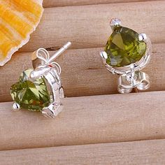 Pair of 2.2ct Peridot stud earrings. Starting at $10 on Tophatter.com!