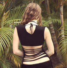 Black tank top with an open back soft and feminine by Shovava, $36.00