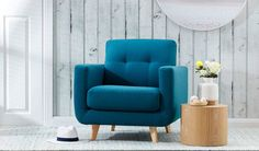 Add a punch of teal to your living space with this brightly coloured teal armchair