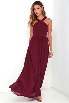 More romantic than a candlelit dinner or a trip to the Eiffel Tower, the Air of Romance Burgundy Maxi Dress will have you feeling the love! Lightweight Georgette falls from a modified halter neckline, into a seamed bodice supported by semi-sheer shoulder straps. A sweeping skirt cascades from a banded waist completing this elegant maxi dress. Hidden zipper with clasp.