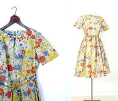 1960s floral print dress with bow at neck and full skirt by Betty Hartford