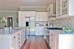 white kitchen with hints of sage green and grey