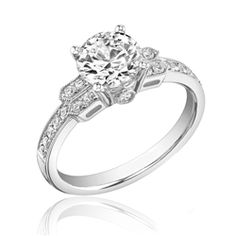 1.25 carat Round Cut Diamond Engagement Ring in 14K White Gold.....I better get this! Or an upgrade!!!