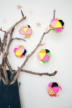 Bare branches and paper ball ornaments.