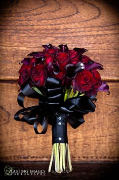 Red and deep purple rose bridal bouquet | Lasting Images Photography | villasiena.cc