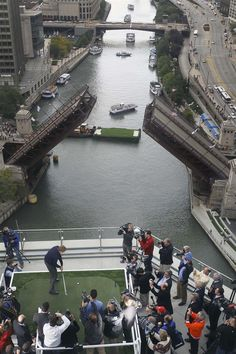 U.S. Ryder Cup captain Davis Love III strikes a ball from the 16th floor terrace of Trump Tower, 220 yards to a green built on a barge on the Chicago River just past Michigan Avenue, Monday, Sept. 26, 2011, in Chicago. The 2012 Ryder Cup will be at the Medinah Country Club in Medinah, Ill.