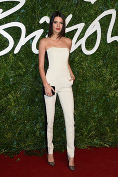 How stunning is Kendall Jenner in this black stripe white jumpsuit and mesh heels? // 2014 British Fashion Awards