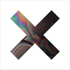 this album cover is very simple, with no use of text. the 'X' has an oil colour effect to it although it is mainly black making it bold on the white background