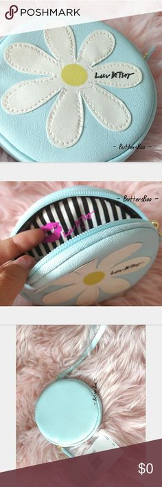 SALE! NWT BETSEY JOHNSON ROUND DAISY CLUTCH Brand new Betsey Johnson daisy clutch.  Can be used to store your coins or other small stuff Original price tag is included. Color is shown in the photos Diameter: 13 cm Clutch handle: 15 cm **Please measure your size in cm before buying to make sure this item fits you **I measured it manually so please allow a few cm off . . Love the dress? I have it listed in my closet  COMES WITH FREE GIFT! Betsey Johnson Bags