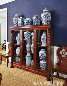 Blue-and-White China: A collection of blue-and-white vases are displayed in a wooden cabinet, carrying the home's repeating palette into the dining room. Blue And White Vase, White Vases, Navy And White, White Trim, Blue Rooms, White Rooms, Delft, Traditional Home Magazine, Keramik Vase