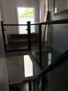 10mm clear tempered glass stair railing.      grandriverglass.com