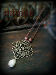 Beautiful bronze ornate pendant with 17mm teardrop freshwater pearl hanging from distressed brown leather.  $18