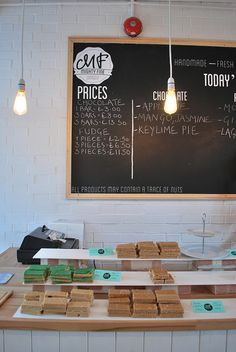 Mighty Fine Chocolate & Fudge Kitchen Creating Artist Statements Great idea tabletop styling home office decorating ideas Cafe Interior, Interior Design, Love Cafe, My Coffee Shop, Desk Layout, Cafe Bistro, Lunch Room, Small Cafe, Cafe Shop