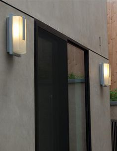 The Neptune wet location wall fixture from Access Lighting has a simple design with a decorative metal overlay. www.accesslighting.com