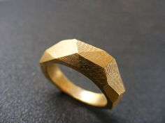 Faceted Geometric Gold Ring This beautiful ring is created from a design i drew and then hand fabricated from brass. I gave it a24k high quality gold
