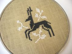 Deer cross stitch design in charcoal gray and white cotton embroidery floss on pale green linen. Adapted from a vintage pattern. Securely mounted in a vintage metal embroidery hoop. Counted Cross Stitch Patterns, Cross Stitch Charts, Cross Stitch Designs, Cross Stitch Embroidery, Crochet Cross, Knit Crochet, Modern Cross Stitch, Embroidery Techniques, Yarn Crafts