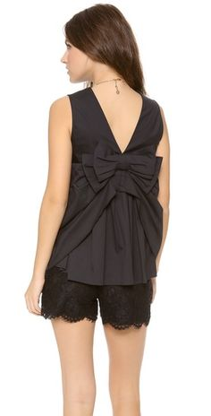 RED Valentino Bow Back Top FREE SHIPPING at shopbop.com. RED Valentino plays with proportions on this sleeveless blouse. An oversized bow and mixed pleating create a bustle effect. Scoop neckline.
