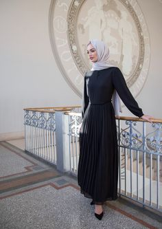 INAYAH | Textured layers and button detail. Encompass both class and sophistication.  Black Pleat Skirt Maxi - only available at our pop up shop! Feather Grey Rayon Hijab -  www.inayah.co