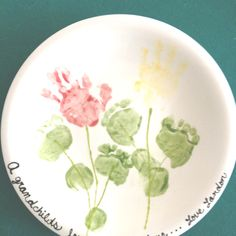 """""""A grandchild's love grows here."""" Grandma's birthday present we made at the paint your own pottery studio"""