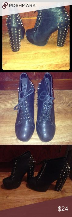 City Snappers Spiked Laced Up Booties Be a rock star in these awesome booties! There's some heel to these but these were very comfortable to me. They danced the night away, and are still in amazing shape. Hardly any scuffing. City Snappers Shoes Heeled Boots