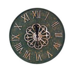 """Wood wall clock in green with Roman numerals and a floral motif.       Product: Clock   Construction Material: Wood    Color: Green and rustAccommodates: Batteries - not included Dimensions: 26"""" Diameter x 2"""" D"""