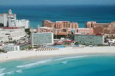 Krystal Cancun, Mexico.  The Krystal, which is in the heart of the Hotel Zone on Punta Cancun, has 453 rooms, and each one has a view of either the Caribbean Sea or Cancun Lagoon. The rooms were also renovated in December 2011 with updates like marble floors, flat-screen TVs, and rain showers.  The Krystal includes a Discover Cancun pass that covers one dinner at a local restaurant.  From $100 per person, per night