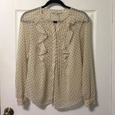 Ann Taylor LOFT Blouse Pretty cream colored with tiny black star print and ruffles in the front. Great fit. LOFT Tops Blouses